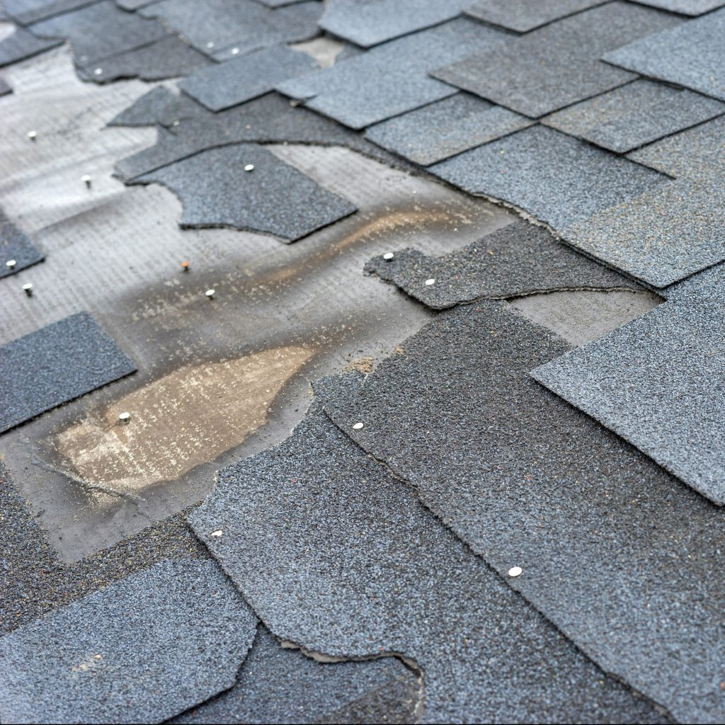 Close Up View of Damages/Torn Bitumen Shingles