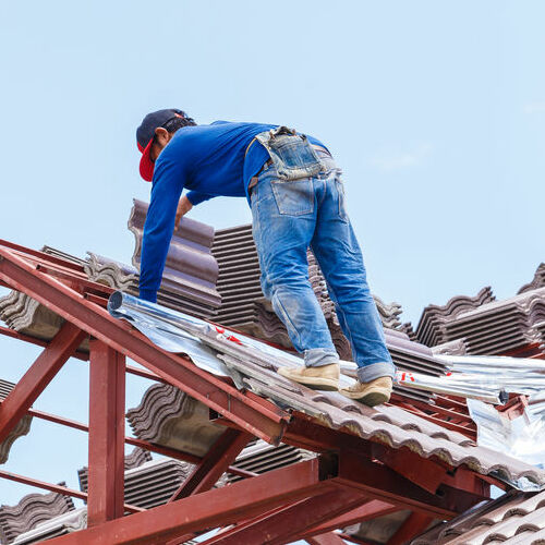 A Roofer Installs Roof Tiles.